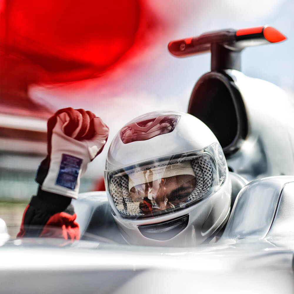Image of a racing driver in the cockpit of his car