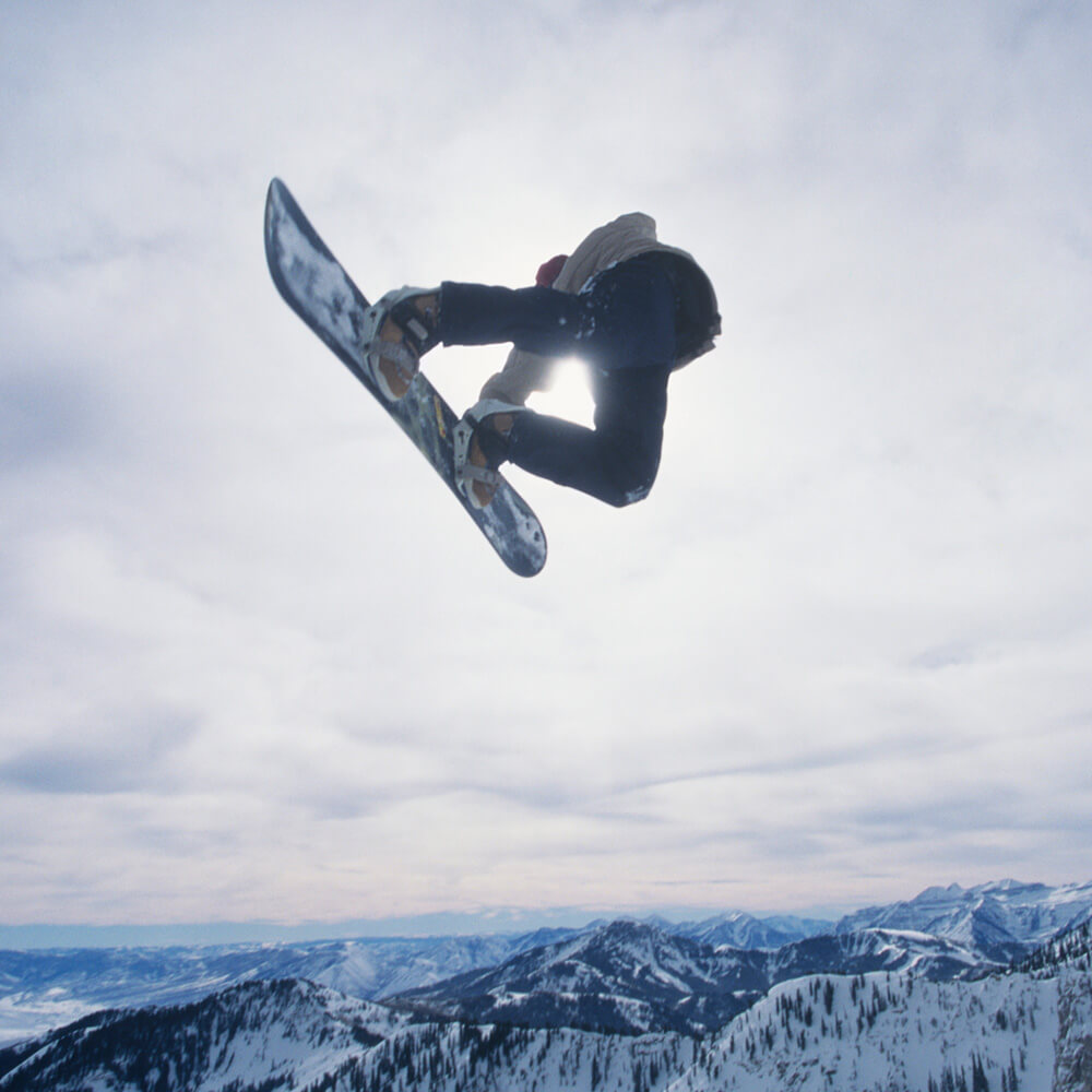 Image of a snowboarder jumping